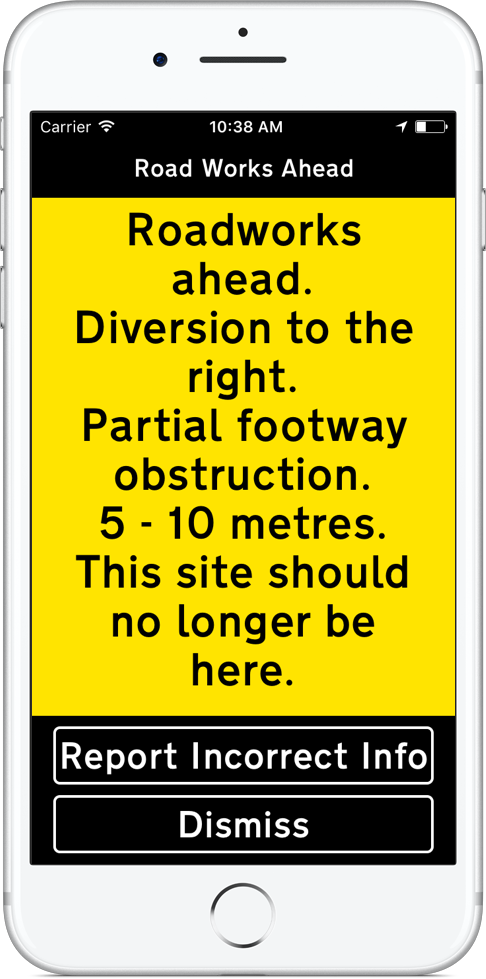 iPhone displaying Roadworks ahead. Diversion to the right. Partial footway obstruction. 5 - 10 metres. This site should no longer be here. In black text on a yellow background